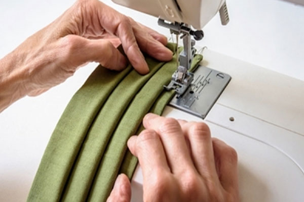 कोरोनो लहर में 3 लेयर वाला कपड़े का मास्क, सर्जिकल मास्क जितना प्रभावी