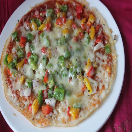 अपने बच्चों के लिए घर में असानी से ऐसे बनाएं पिज्जा डोसा....